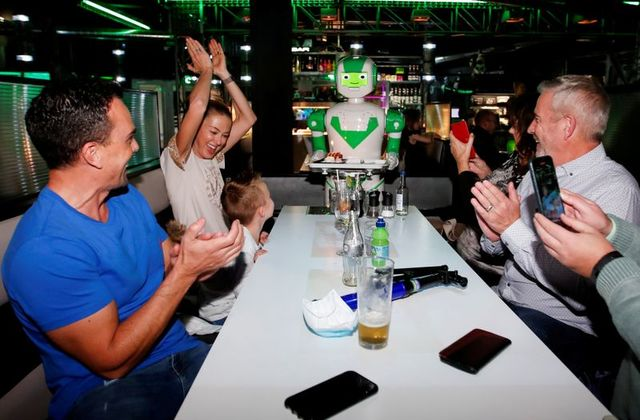 a-robot-delivers-a-birthday-cake-at-robotazia-restaurant-as-the-coronavirus-disease-covid-19-outbreak-continues-in-milton-keynes-britain-october-2-2020-photo-reuters
