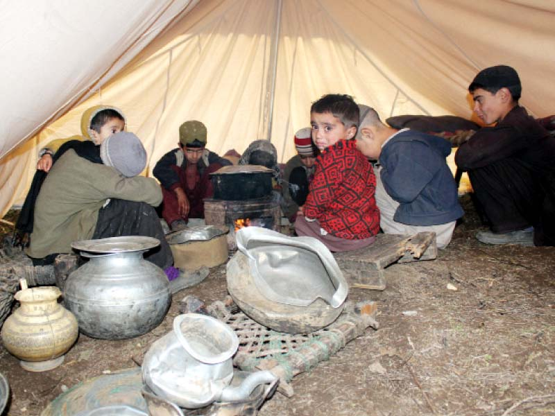 under the debris seventy year old mina fights shangla s cold winter in a tent