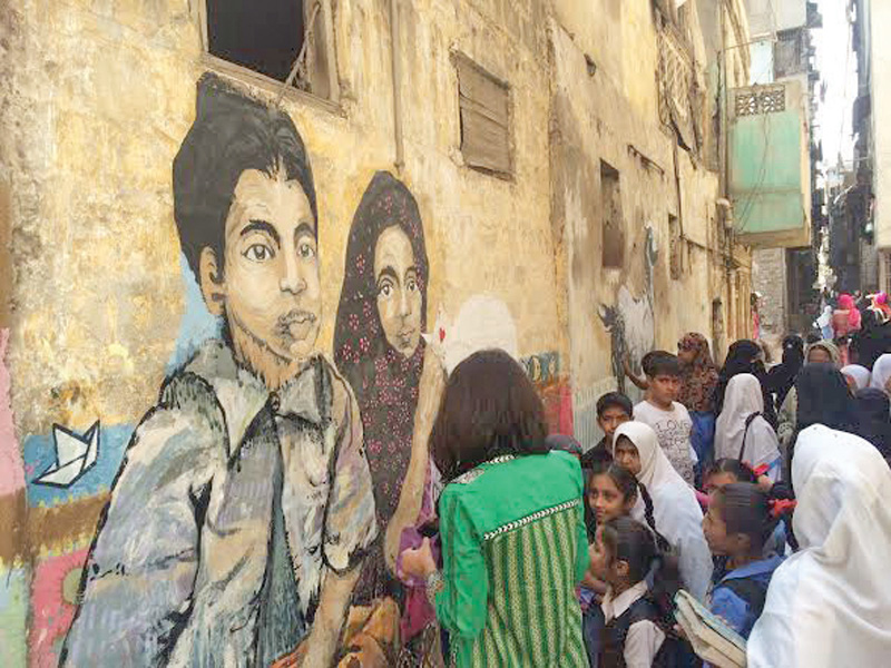the fearless collective painted a few walls in lyari on wednesday morning with excited children watching them work the paintings were based on the theme play photo express