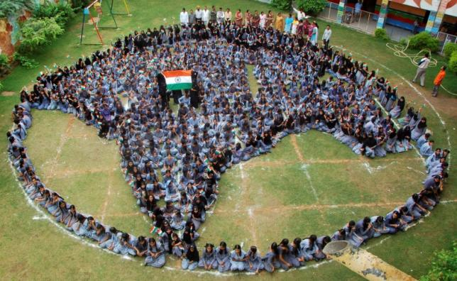 Schoolgirls form shape of India as they pray for world peace during Ramadan at Jodhpur. PHOTO: REUTERS
