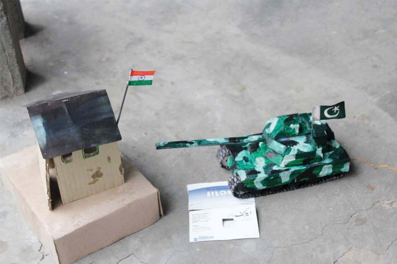 inspired by war 18 year old makes tanks helicopters with trash