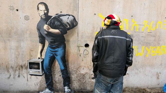 banksy s new work shows steve jobs as migrant