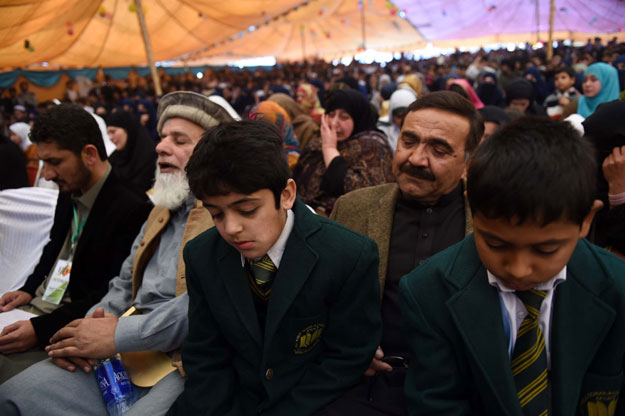 n this photograph taken on December 8, 2015, Pakistani family members and parents of the victims of the deadliest Taliban assault on an army-run school in the northwestern city of Peshawar on December 16, 2014, attend a ceremony at Peshawar University to pay tributes to the victims. PHOTO: AFP