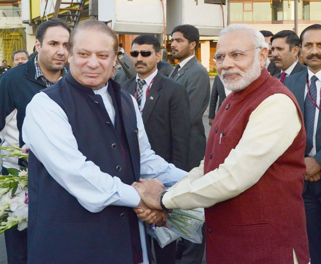pm nawaz sharif shakes hands with his indian counterpart narendra modi upon latter 039 s arrival at the allama iqbal international airport in lahore on december 25 2015 photo pid