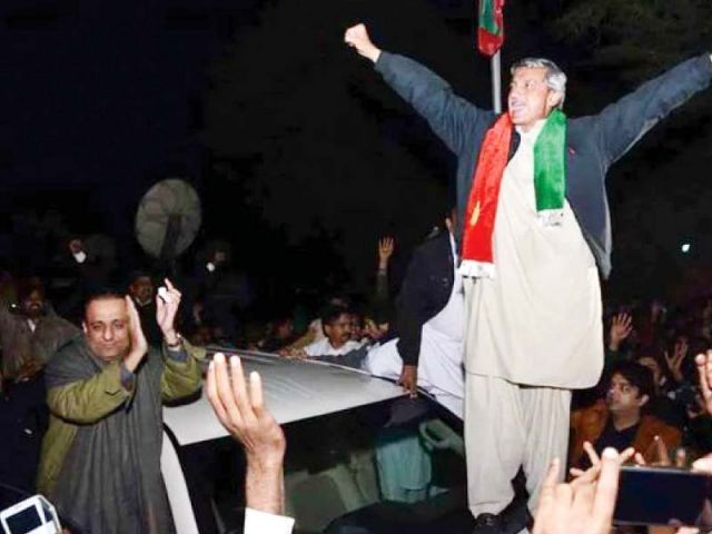 PTI leader Jahangir Khan Tareen celebrates his victory during a rally in Lodhran. PHOTO: PTI