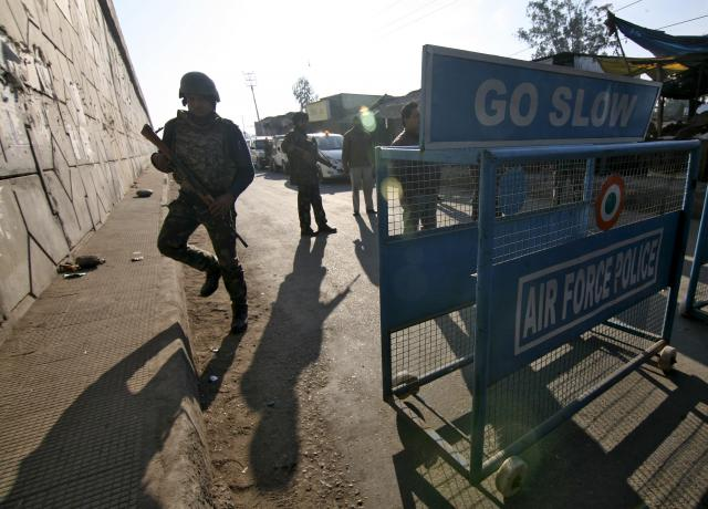 Indian security personnel stand guard next to a barricade outside the Indian Air Force (IAF) base at Pathankot in Punjab, India, January 2, 2016. PHOTO: REUTERS