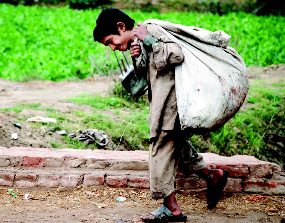 file photo of a street child carrying heavy load photo israrul haq file