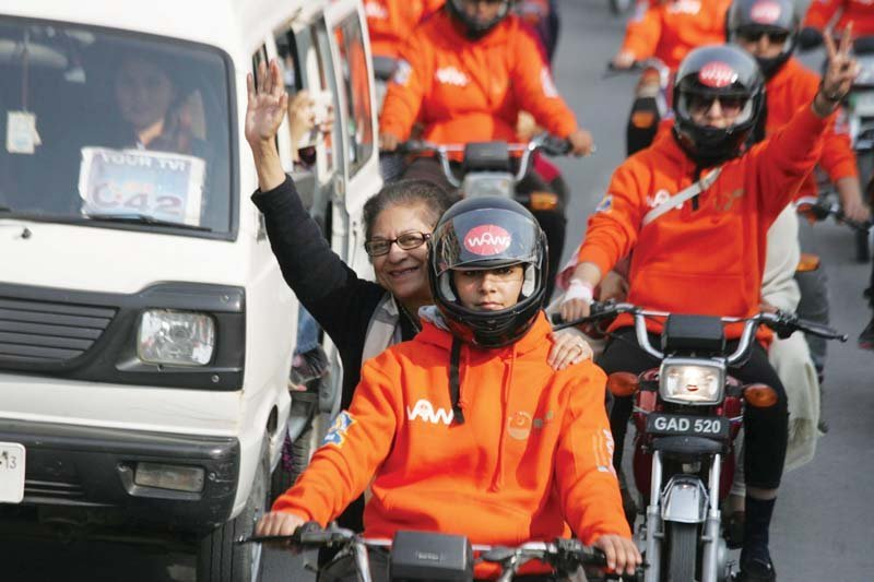 advocate asma jahangir rides pillion l two participants get set for the rally r photo shafiq malik express