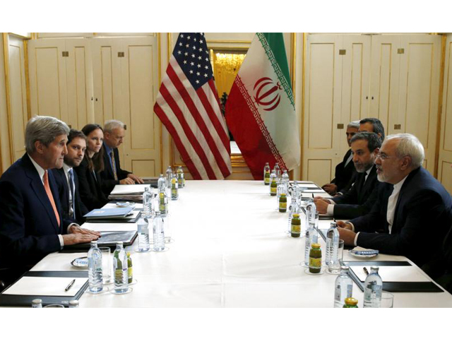 "US Secretary of State John Kerry (L) meets with Iranian Foreign Minister Mohammad Javad Zarif on what is expected to be ""implementation day,"" the day the International Atomic Energy Agency (IAEA) verifies that Iran has met all conditions under the nuclear deal, in Vienna January 16, 2016. PHOTO: REUTERS"