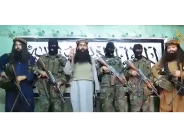 This still image taken from a video released by a faction within the Pakistani Taliban on January 22, 2016 shows their leader Khalifa Umar Mansoor (C) with militants delivering a statement from an undisclosed location.