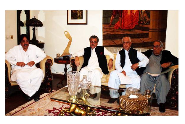 Pir Sadaruddin Shah Rashdi presiding over a meeting of Grand Democratic Alliance at his residence. PHOTO: ONLINE