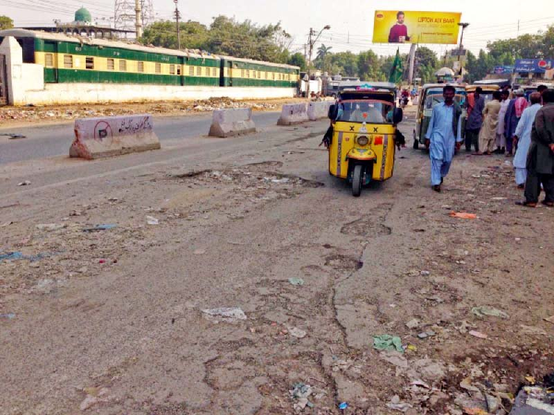 the road outside the karachi cantt railway station known as dr daudpota road is in such a dilapidated state that its condition has led to severe traffic congestion in the area resulting in commuters failure to catch their trains on time photo express