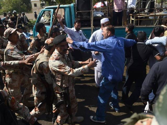rangers baton charge on employees of pakistan international airlines pia during a protest near karachi international airport in karachi on february 2 2016 photo afp