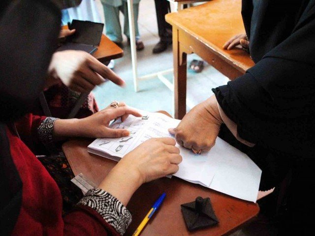 Eyebrows raised over low voter turnout in Lahore and Karachi. PHOTO: PPI
