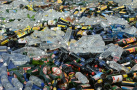 bottles of alcohol sit spread out before being destroyed by authorities ahead of the holy month of ramadan at a police station in jakarta photo afp