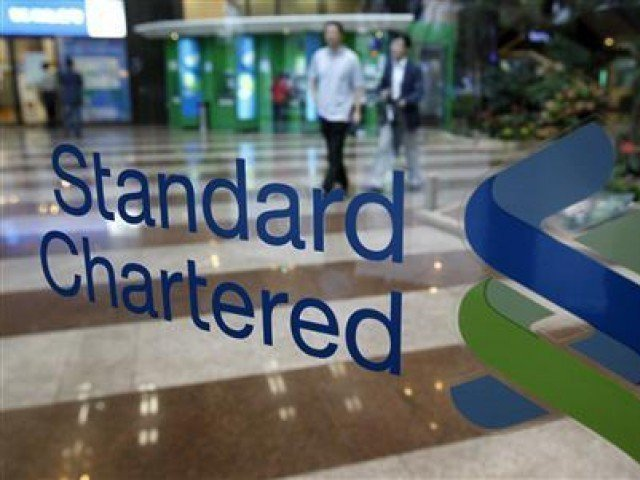 standard chartered bank to double business in pakistan