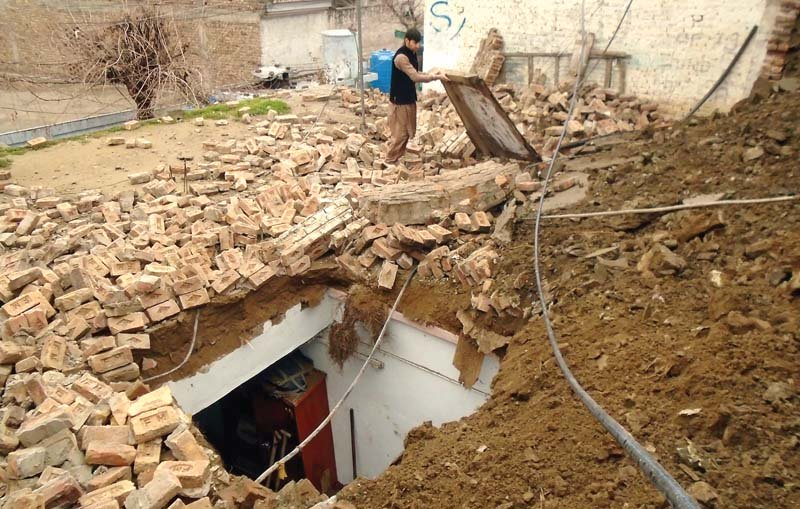 Debris of the wall of a house that collapse in Lower Dir. PHOTO: INP
