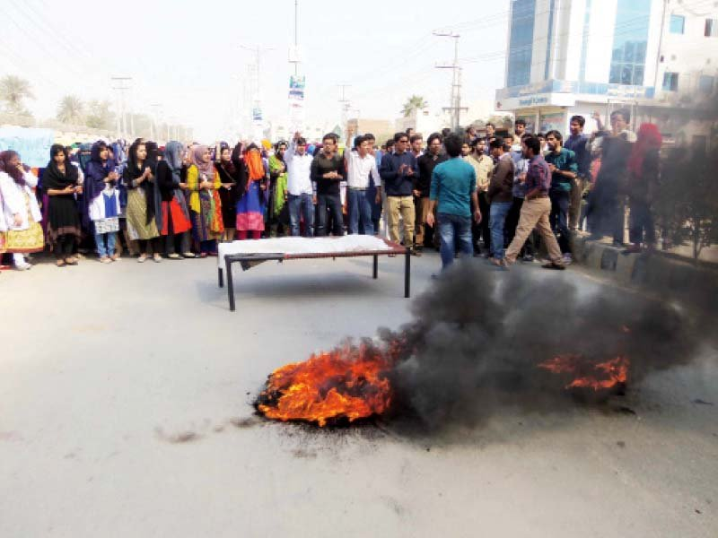 Students of Dera Ghazi Medical College holding a mock funeral. PHOTO: EXPRESS