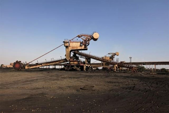 A universal machine made in the USSR stands in open ground near the conveyer belt at coal handling plant at the Pakistan Steel Mills (PSM) on the outskirts of Karachi, Pakistan, February 8, 2016. PHOTO: REUTERS