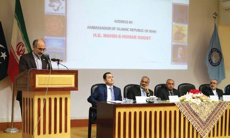 the iranian ambassador mehdi i honar doost addresses inaugural session on cultural and lingual commonalities between iran and pakistan at numl on wednesday photo express