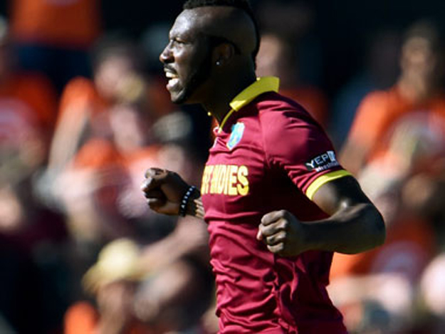 Andre Russell exults after a wicket. PHOTO: AFP