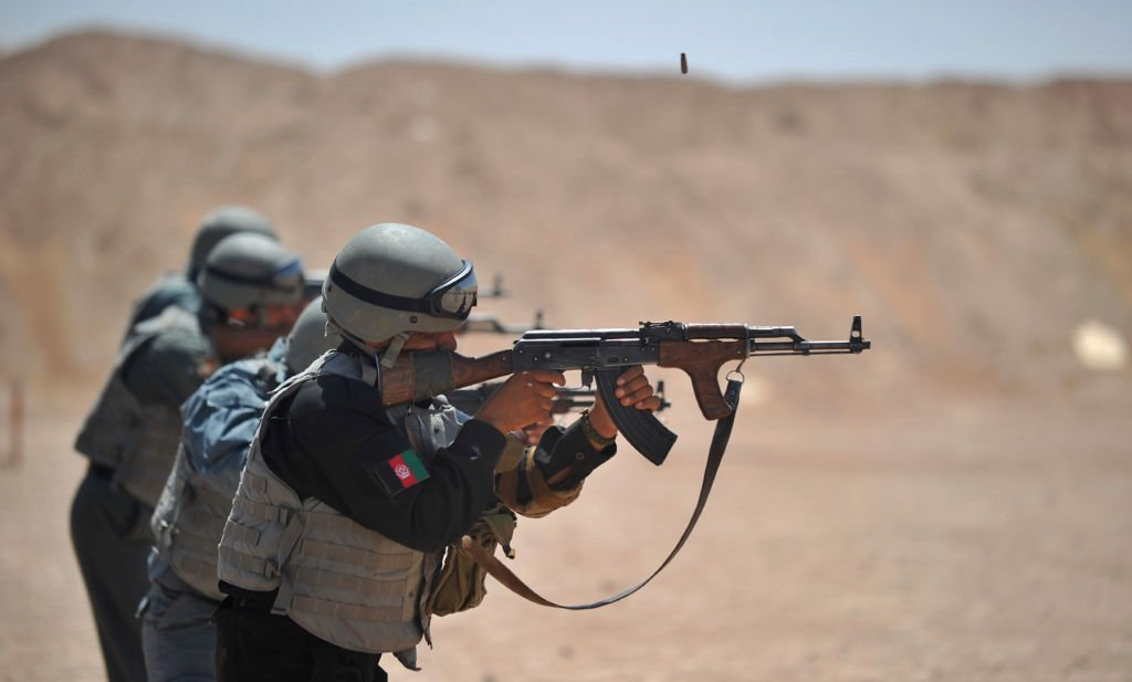 members of the afghanistan national policemen fire their ak 47 rifles during a shooting course taught by us marines at camp leatherneck in helmand province on june 19 2012 photo afp