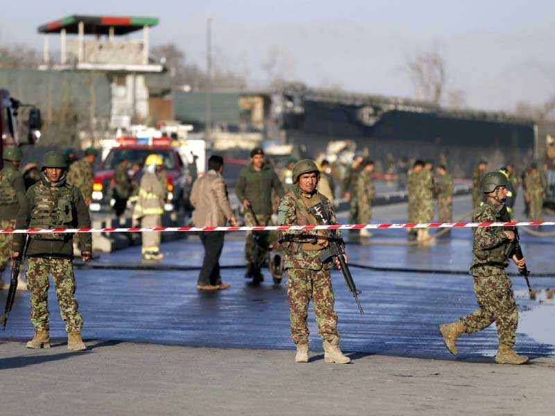 afghan soldiers keep watch at the site of the attack in kabul photo reuters