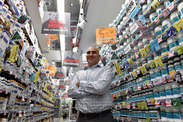 n this picture taken on february 16 2016 peter barraket who heads up quot mr vitamins quot a chain of supplement outlets in sydney poses next to shelves packed with vitamins in his chatswood outlet asian consumers determined to improve their lifestyle are boosting the fortunes of australian producers of premium baby milk formula vitamins and honey as the region 039 s burgeoning middle class jumps on the health food bandwagon photo afp