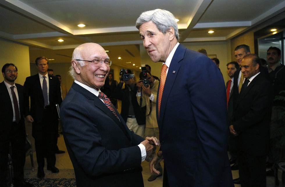 in this file photo us secretary of state john kerry is greeted by national security advisor sartaj aziz l shortly after arriving in islamabad on january 12 2015 photo afp