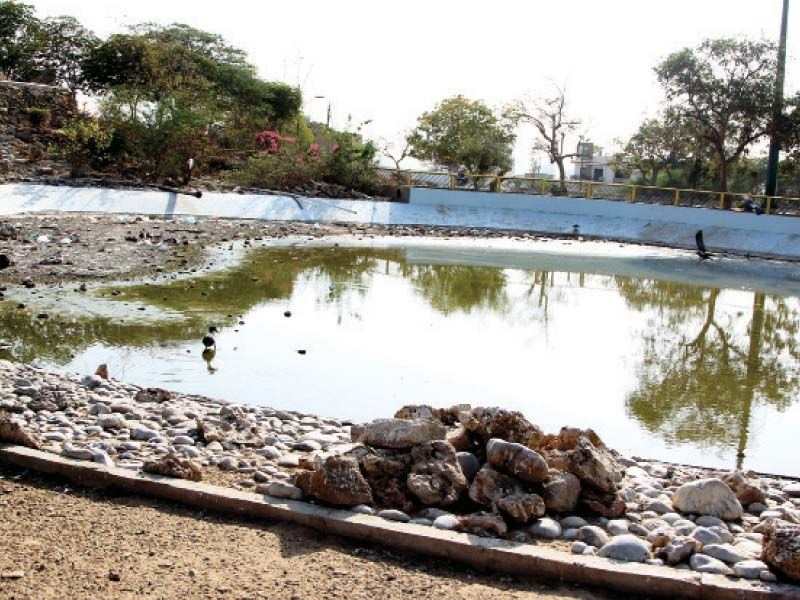 the lake with a fountain in the middle is littered with garbage and its water nearly dried up photo aysha saleem express