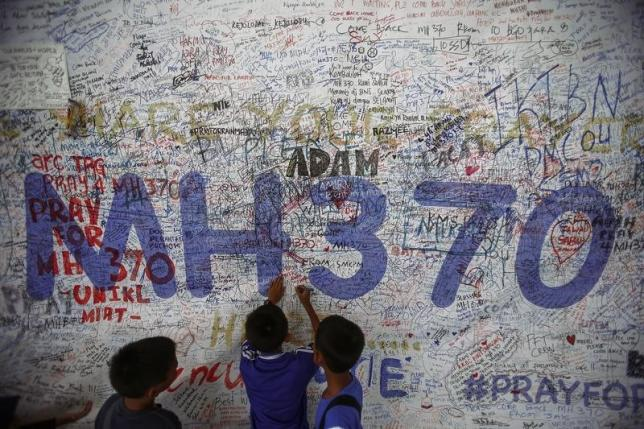 children write messages of hope for passengers of missing malaysia airlines flight mh370 at kuala lumpur international airport photo reuters