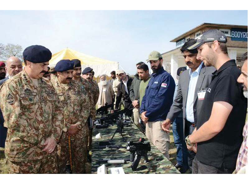 general raheel sharif inspects arms and ammunition during his visit to pof wah on tuesday photo ppi