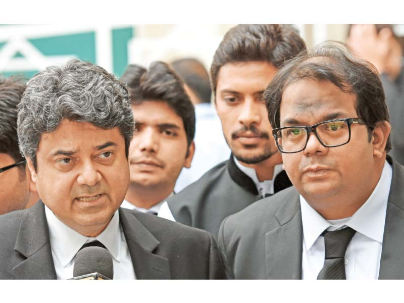 Farogh Naseem and Faisal Hussain lawyers of Pervez Musharraf talk to the media outside the Supreme Court. PHOTO: AFP