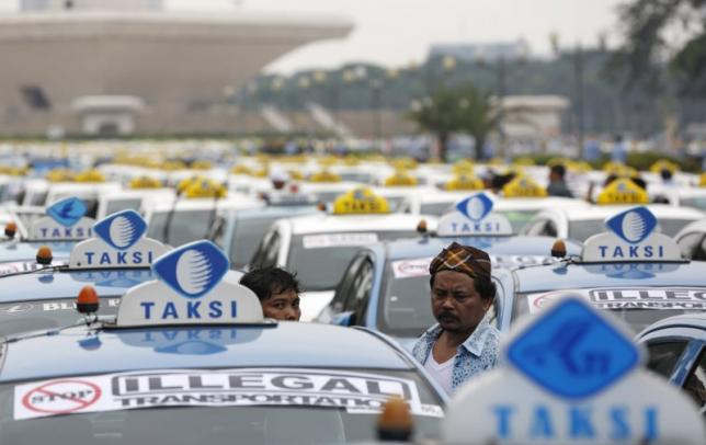 indonesian taxi drivers to rally for ban on online taxi apps