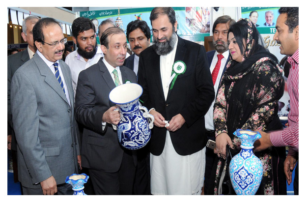 tevta chairperson irfan qaiser sheikh is briefing the state minister for education baligh ur rehman about the projects prepared by tevta students photo inp