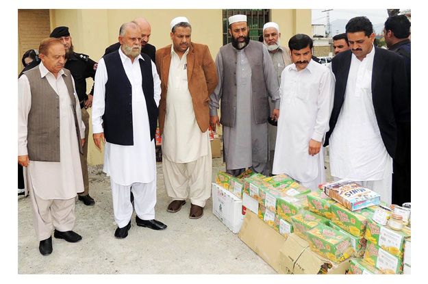 adviser to the chief minister on food qalandar khan lodhi examining substandard food products at district food controller office photo online