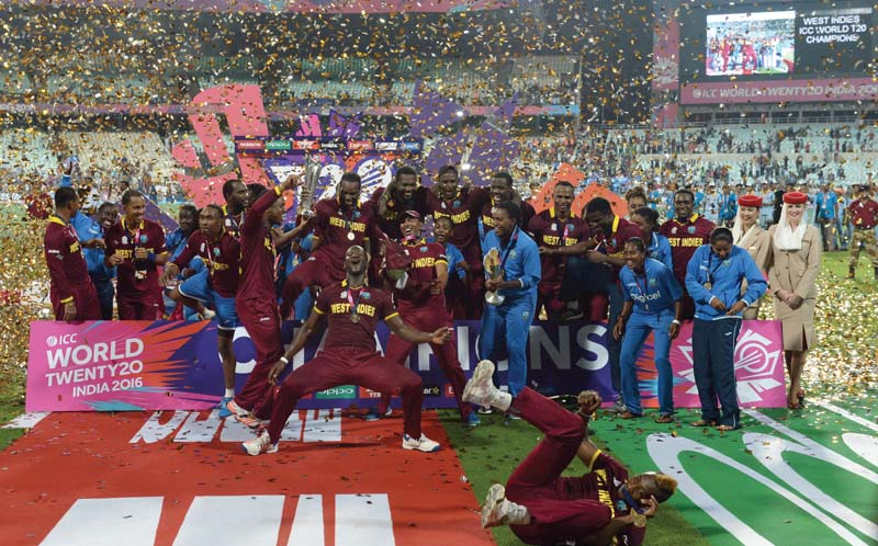 members of the west indies men s and women s teams celebrate their world t20 victories photo afp