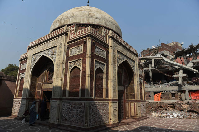 in this photograph taken on february 24 2016 the remains r of an illegally constructed building that has been demolished are seen near the tomb of atgah khan in the nizamuddin area of new delhi photo afp