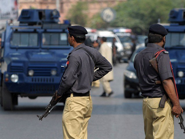 a minor girl was also injured when unidentified persons opened fire on a police mobile near nagan chowrangi photo afp