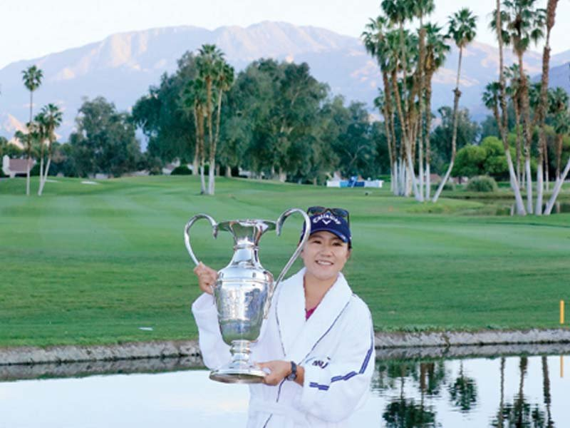 ko poses with the trophy after the final round of the ana inspiration at the mission hills country club photo afp