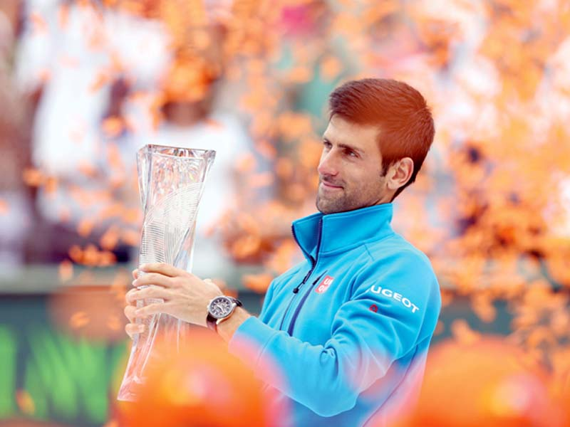 djokovic holds aloft the miami open trophy following his straight set victory over nishikori in the men s final photo afp