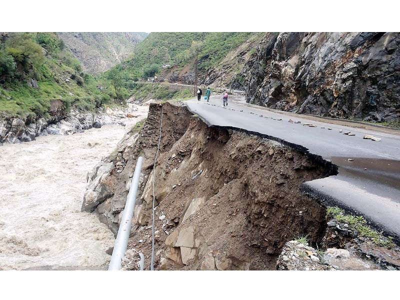 a view of alpuri road due to landsliding in besham shangla district photo inp