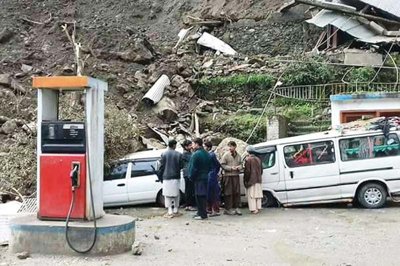 locals gather a petrol station in kohistan where vehicles were damaged by landslides photo online