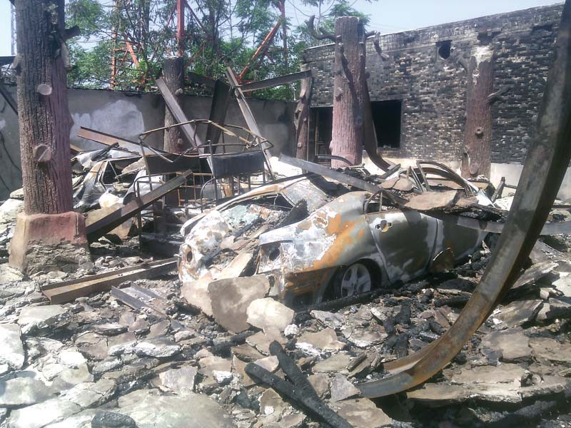 the damaged vehicles at the guesthouse photo express