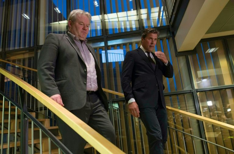iceland 039 s new prime minister sigurdur ingi johannsson l of the progressive party s and bjarni benediktsson finance minister of the independence party arrive to address members of the media in reykjavik iceland on april 6 2016 photo afp