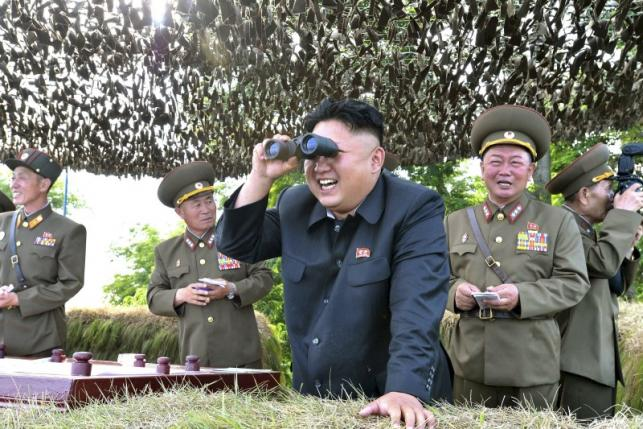 north korean leader kim jong un looks through a pair of binoculars during an inspection of the hwa islet defence detachment standing guard over a forward post off the east coast of the korean peninsula in this undated file photo released by north korea 039 s korean central news photo reuters