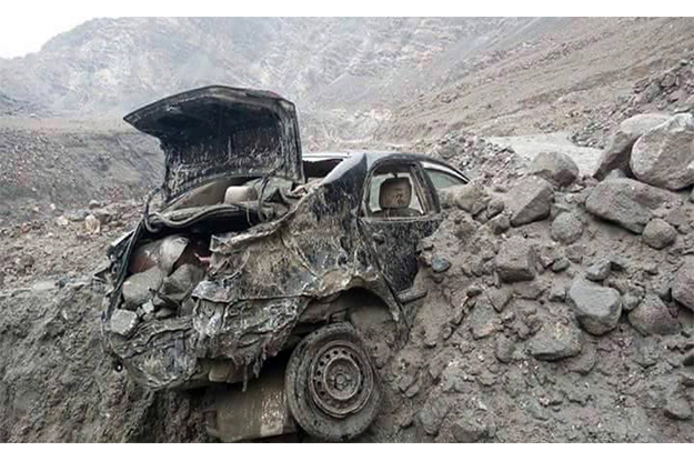 a view of destroyed car by landslide and flash floods following heavy rains in gilgit baltistan photo online