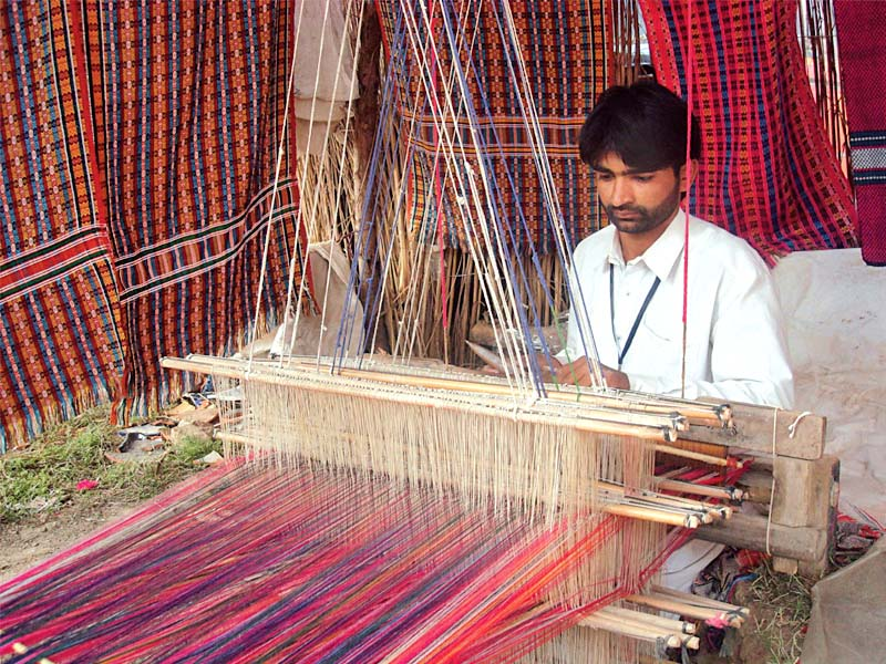 fabric made from traditional methods is expensive compared to the power loomed khaddar photo file
