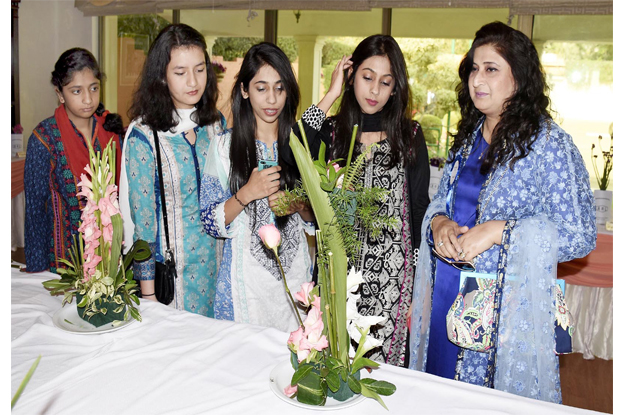 women keenly looking at the flowers during the exhibition photo inp