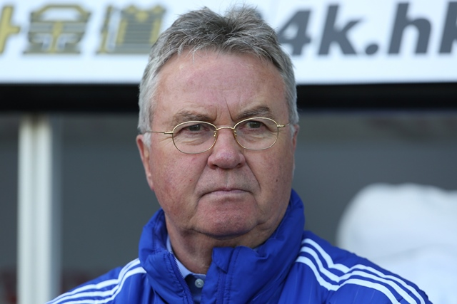 guus hiddink watches his players warm up ahead of the english premier league football match between swansea city and chelsea at the liberty stadium in swansea south wales on april 9 2016 photo afp